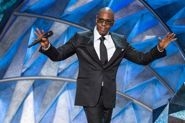dave chappelle in a suit.