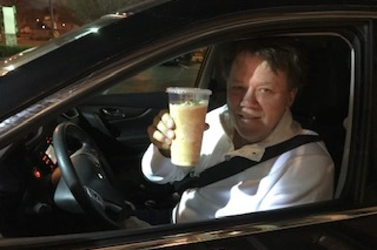 DJ in car with coffee