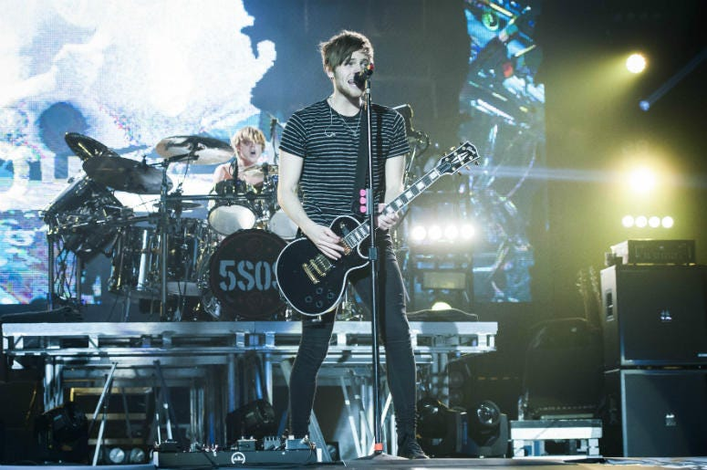 4/7/2016 - Luke Hemmings of 5 Seconds of Summer on stage at the O2 Arena, Greenwich - London