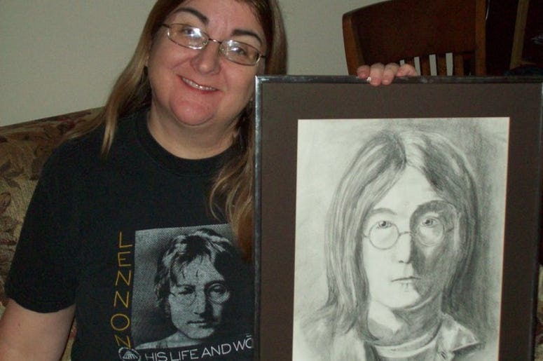 Kitty Dunn and a drawing of John Lennon