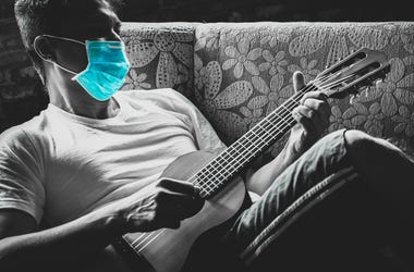 guitar player with mask