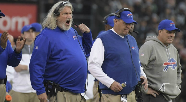 Former Buffalo Bills defensive coordinator Rob Ryan (left) and brother/head coach Rex Ryan react in the fourth quarter against the Oakland Raiders during a NFL football game at Oakland Coliseum.