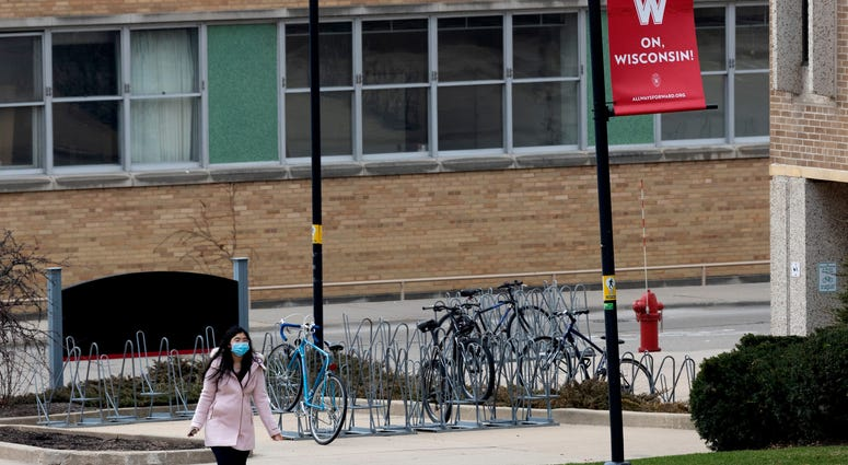 A UW-Madison student walks on an empty campus