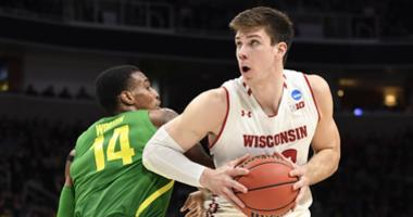 Wisconsin exits early