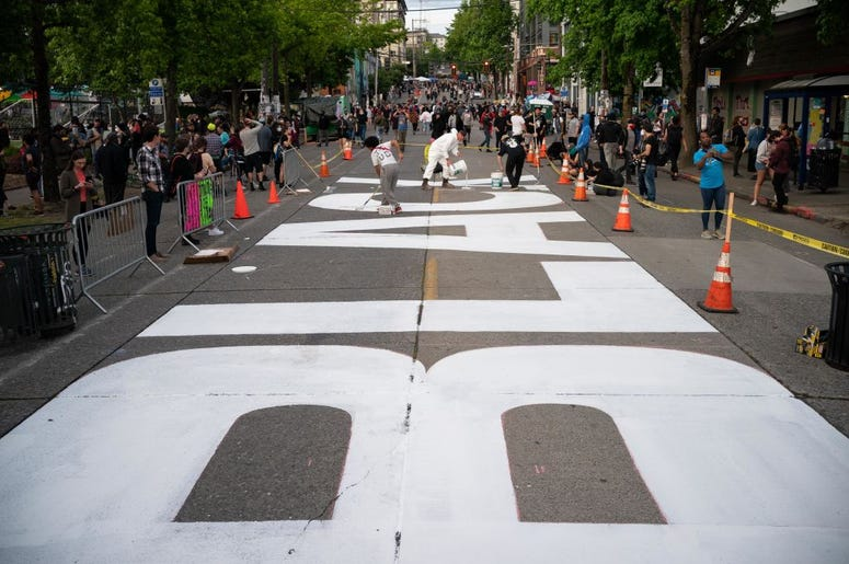 Black Lives Matter painted on Pine Street in Seattle