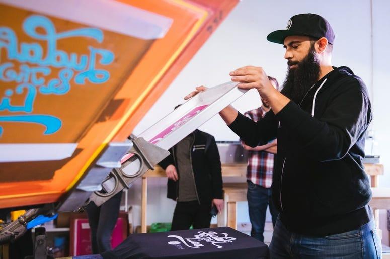 Keith printing shirts at Inker Prints