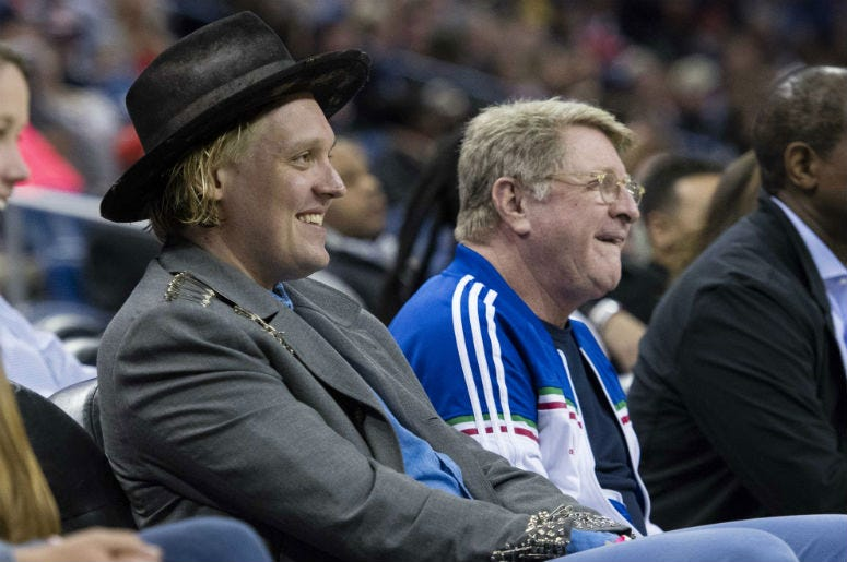 Musician Win Butler (hat) of rock group Arcade Fire watches the game between the New Orleans Pelicans and the LA Clippers at the Smoothie King Center.