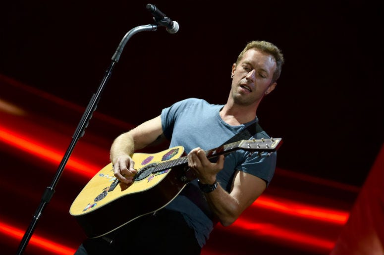 Chris Martin of Coldplay performs onstage