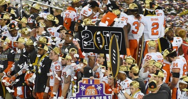The Clemson Tigers celebrate after defeating the Alabama Crimson Tide in the 2017 College Football Playoff National Championship Game at Raymond James Stadium.