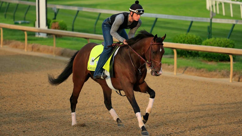 Omaha Beach, who was scratched from the 2019 Kentucky Derby, works out on the track.