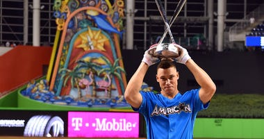 American League outfielder Aaron Judge (99) of the New York Yankees holds up the trophy after winning the 2017 MLB Home Run Derby at Marlins Park.