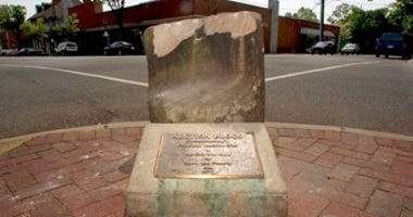 The historic pre-civil war auction block for slaves and property at the corner of Charles and William Streets in downtown Fredericksburg, Va. (Reza A Marvashti/The Free Lance-Star via AP, File)
