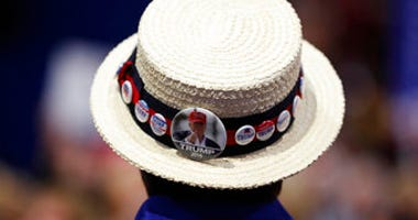 FILE - In this July 20, 2016 file photo, a delegate shows off support for Republican Presidential Candidate Donald Trump during the third day session of the Republican National Convention in Cleveland. (AP Photo/Carolyn Kaster)