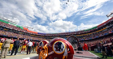 FILE - In this Sept. 18, 2016, file photo, F-26 fighter jets from the DC Air National Guard fly over FedEx Field before an NFL football game against between the Washington Redskins and the Dallas Cowboys in Landover, Md. (AP Photo/Nick Wass, File)