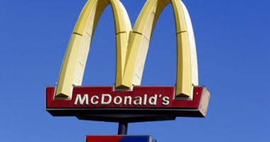 FILE - This Oct. 17, 2019 file photo shows a McDonald's sign along Interstate 40/85 in Burlington, N.C.  (AP Photo/Gerry Broome, File)