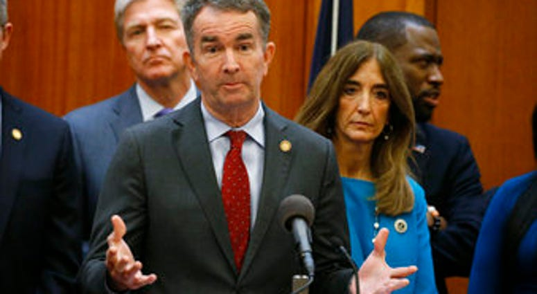 FILE - In this March 12, 2020 file photo, Virginia Gov. Ralph Northam gestures during a news conference as House speaker Eileen Filler-Corn and Secretary of Public safety Brian Moran look on at the State Capitol. (AP Photo/Steve Helber, File)