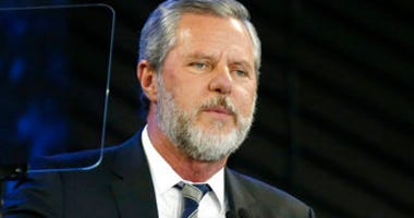 FILE - In this Nov. 28, 2018, file photo, Liberty University President Jerry Falwell Jr. speaks before a convocation at the university in Lynchburg, Va. (AP Photo/Steve Helber, File)