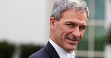 FILE - In this March 20, 2020 file photo, Acting Deputy Secretary for the Department of Homeland Security Ken Cuccinelli speaks about the coronavirus outside the West Wing of the White House in Washington. (AP Photo/Alex Brandon)