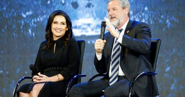 FILE -This Wednesday Nov. 28, 2018 file photo shows Rev. Jerry Falwell Jr., right, and his wife, Becky during after a town hall at a convocation at Liberty University in Lynchburg, Va. (AP Photo/Steve Helber)
