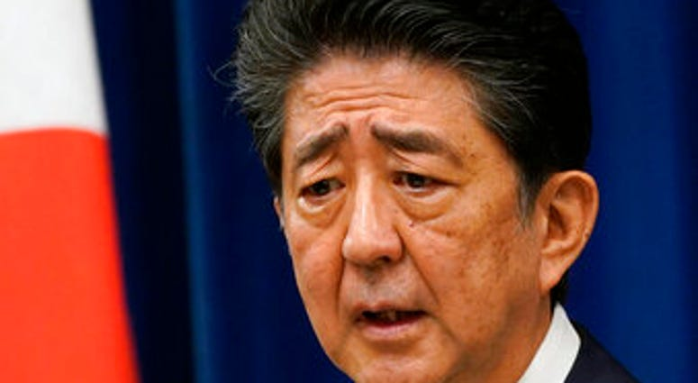 Japanese Prime Minister Shinzo Abe speaks during a press conference at the prime minister official residence in Tokyo Friday, Aug. 28, 2020. (Franck Robichon/Pool Photo via AP)