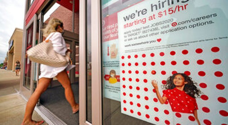 FILE - In this Sept. 2, 2020, file photo, a help wanted sign hangs on the door of a Target store in Uniontown, Pa. (AP Photo/Gene J. Puskar, File)