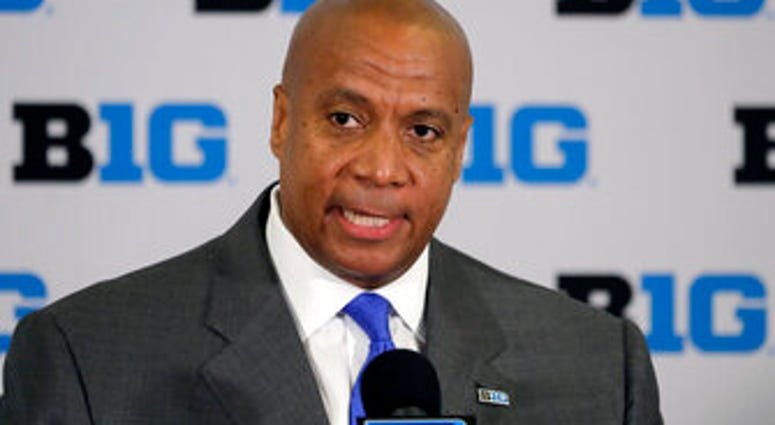 FILE - In this June 4, 2019, file photo, Kevin Warren talks to reporters after being named Big Ten Conference Commissioner during a news conference in Rosemont, Ill. (AP Photo/Charles Rex Arbogast, File)