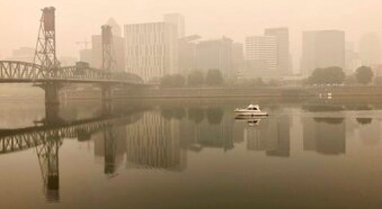 A view of downtown Portland from the East Bank Esplanade is seen on Monday, Sept. 14, 2020. (AP Photo/Gillian Flaccus)