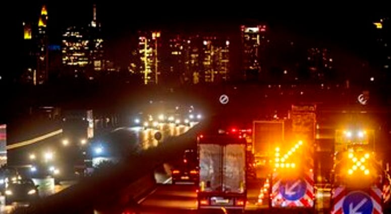 In this image taken from video a mattress burns in the street near the Portland Police Bureau's North Precinct Sunday night, Sept. 6, 2020, in Portland, Ore. (KATU Photo via AP)