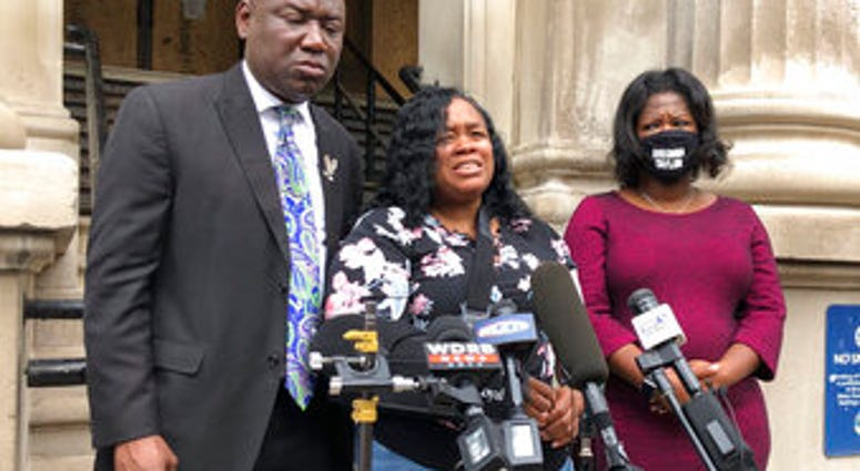 FILE - Tamika Palmer, mother of Breonna Taylor, addresses the media in Louisville, Ky., on Thursday, Aug. 13, 2020. (AP Photo/Dylan Lovan, FIle)