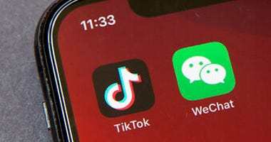 FILE - Icons for the smartphone apps TikTok and WeChat are seen on a smartphone screen in Beijing, in a Friday, Aug. 7, 2020 file photo. (AP Photo/Mark Schiefelbein, File)