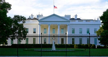 FILE - In this Saturday, Sept. 19, 2020, file photo, an American flag flies at half-staff over the White House in Washington. (AP Photo/Patrick Semansky, File)