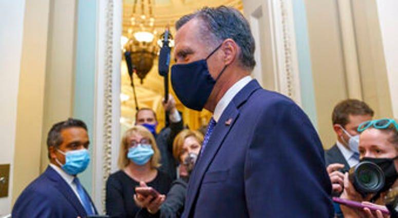 Sen. Mitt Romney, R-Utah, leaves the Senate Chamber following a vote, at the Capitol in Washington, Monday, Sept. 21, 2020. (AP Photo/J. Scott Applewhite)