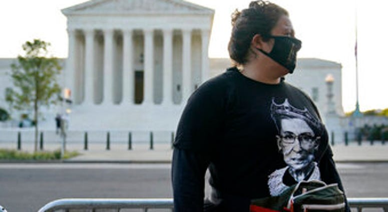 Kara Stewart of Martin, Ky., stands outside the Supreme Court in Washington, Wednesday, Sept. 23, 2020, before a private ceremony and public viewing of Justice Ruth Bader Ginsburg. Ginsburg, 87, died of cancer on Sept. 18. (AP Photo/Patrick Semansky)