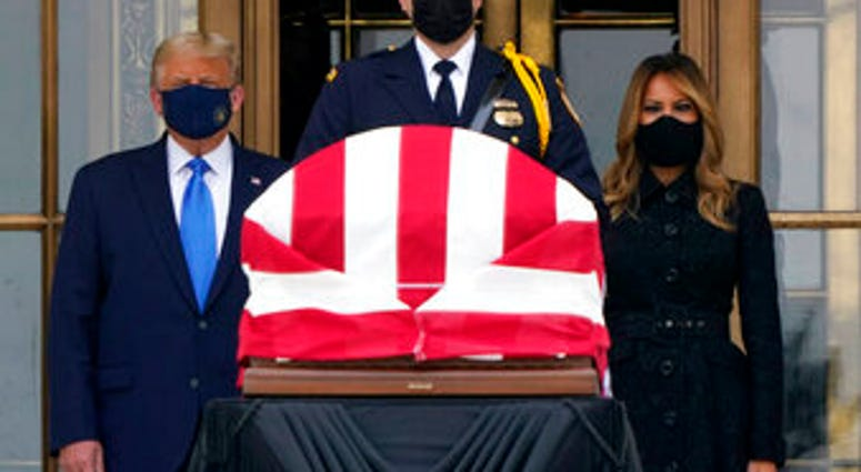 President Donald Trump and first lady Melania Trump pay respects as Justice Ruth Bader Ginsburg lies in repose at the Supreme Court building on Thursday, Sept. 24, 2020, in Washington. Ginsburg, 87, died of cancer. (AP Photo/J. Scott Applewhite)