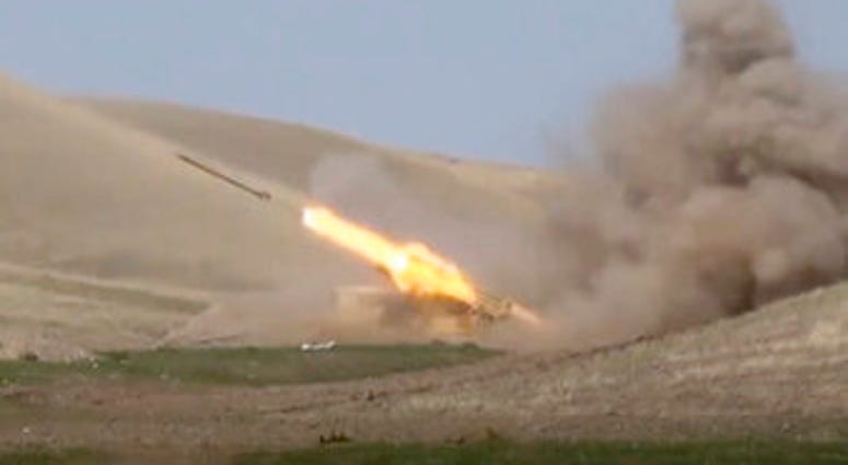 In this image taken from footage released by Azerbaijan's Defense Ministry on Sunday, an Azerbaijan's rocket launches from missile system at the contact line of the self-proclaimed Republic of Nagorno-Karabakh. (Azerbaijan's Defense Ministry via AP)