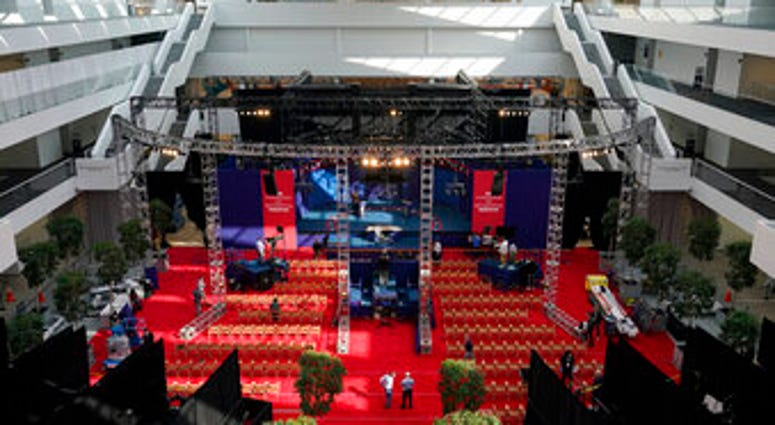 Preparations take place for the first Presidential debate in the Sheila and Eric Samson Pavilion, Monday, Sept. 28, 2020, in Cleveland. (AP Photo/Patrick Semansky)