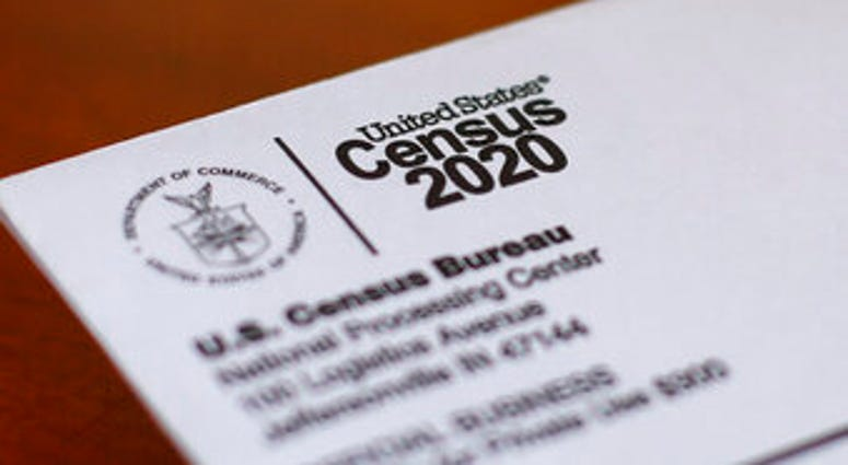 FILE - This Sunday, April 5, 2020, file photo shows an envelope containing a 2020 census letter mailed to a U.S. resident in Detroit. (AP Photo/Paul Sancya, File)