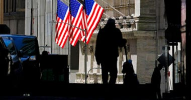 FILE - In this Oct. 14, 2020 file photo, pedestrians pass the New York Stock Exchange in New York. Stocks are ticking higher Wednesday, Nov. 11, and this time big technology stocks are rising too on Wall Street. (AP Photo/Frank Franklin II, File)