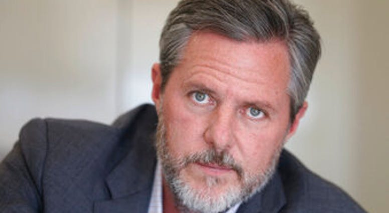 FILE - In this Nov. 16, 2016 file photo, Liberty University president Jerry Falwell Jr., poses during an interview in his offices at the school in Lynchburg, Va. (AP Photo/Steve Helber, File)