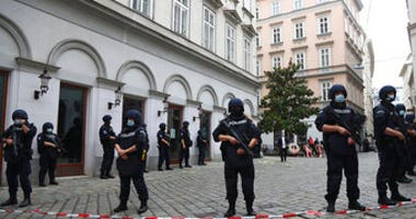 Police officers guard the scene in Vienna, Austria, Tuesday, Nov. 3, 2020. (AP Photo/Matthias Schrader)