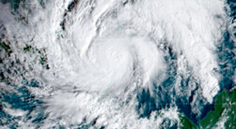 This GeoColor satellite image taken Tuesday, Nov. 3, 2020, and provided by NOAA, shows Hurricane Eta in the Caribbean Sea, arriving at Nicaragua's northern shore. Eta inched closer on Tuesday as a Category 4 storm. (NOAA via AP)