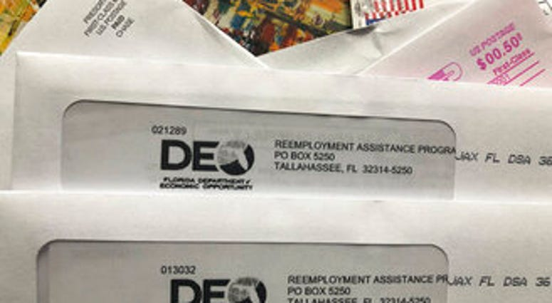 Envelopes from the Florida Department of Economic Opportunity Reemployment Assistance Program are shown, Thursday, Nov. 5, 2020, in Surfside, Fla. (AP Photo/Wilfredo Lee)