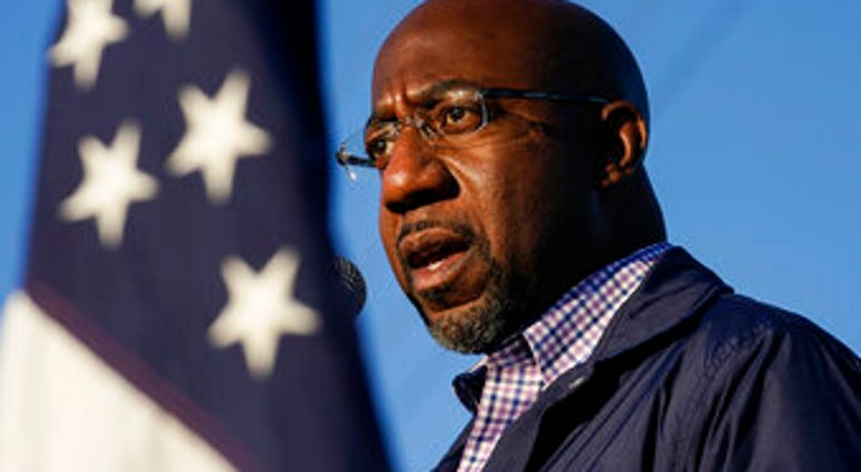 FILE - In this Nov. 15, 2020, file photo Raphael Warnock, a Democratic candidate for the U.S. Senate, speaks during a campaign rally in Marietta, Ga. (AP Photo/Brynn Anderson, File)