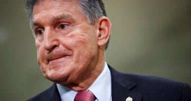 FILE - In this Feb. 5, 2020, file photo, Sen. Joe Manchin, D-W.Va., speaks with reporters on Capitol Hill in Washington. (AP Photo/Patrick Semansky, File)