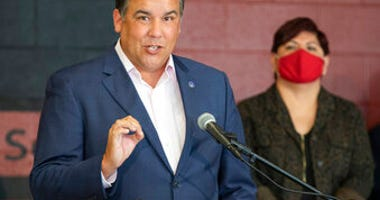 FILE - In this Tuesday, July 28, 2020 file photo, Columbus Mayor Andrew Ginther makes remarks. (Adam Cairns/The Columbus Dispatch via AP, File)