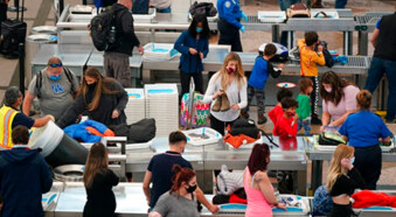Airport Tuesday, Dec. 22, 2020, in Denver. (AP Photo/David Zalubowski)