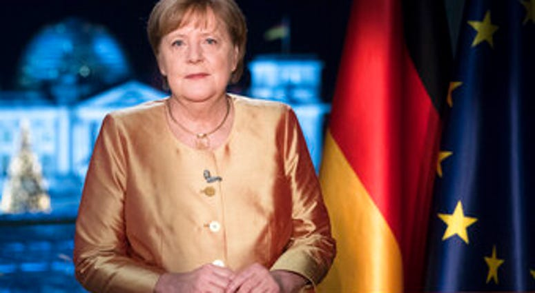 FILE - In this Dec. 30, 2020 file photo German Chancellor Angela Merkel poses for photographs after the television recording of her annual New Year's speech at the chancellery in Berlin, Germany. (AP Photo/Markus Schreiber, File)
