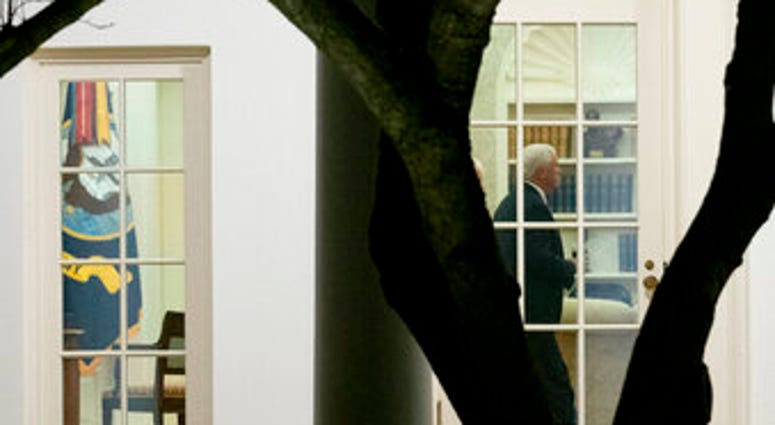 Vice President Mike Pence walks through the Oval Office before President Donald Trump departs the White House in Washington, Monday, Jan. 4, 2021. (AP Photo/Andrew Harnik)