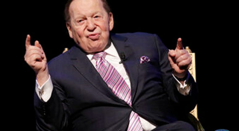 FILE - In this Sept. 13, 2016 file photo, U.S. billionaire Sheldon Adelson speaks during a news conference for the opening of Parisian Macao in Macau. (AP Photo/Kin Cheung, File)