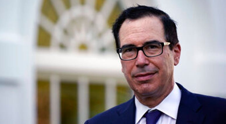 FILE - This Aug. 24, 2020 file photo shows Treasury Secretary Stephen Mnuchin at the White House in Washington. (AP Photo/J. Scott Applewhite, File)